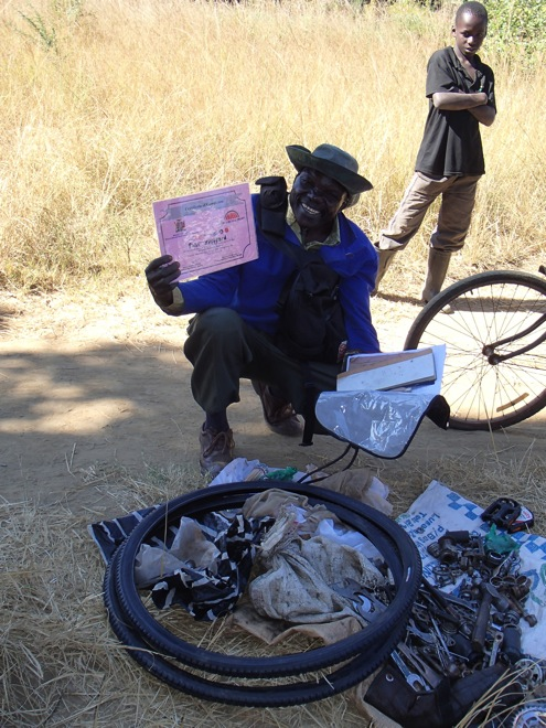 A field mechanic with his certificate